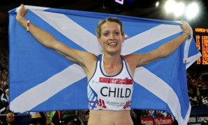 Eilidh Child of Scotland holds her country's flag