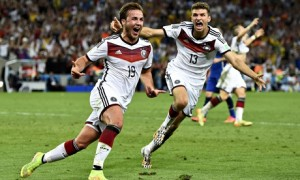 Germany's Mario G¶tze (left) celebrates with Thomas Muller after scoring the winning goal during ext