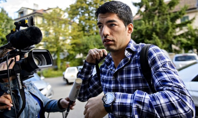 Football: Luis Suarez loses appeal against four-month biting ban but clear to train